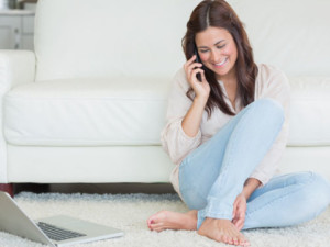 sitting woman on phone